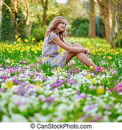 Happy young girl in park on a spring day