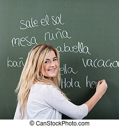 Happy young girl in Spanish class - Happy young girl student...
