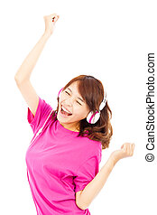 happy young girl listening and enjoying music in headphones