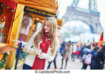 Happy young girl on a Parisian Christmas market - Happy...