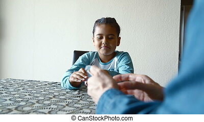 Happy young girl playing cards