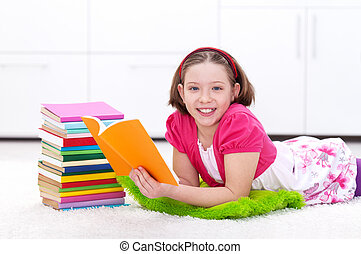 Happy young girl reading