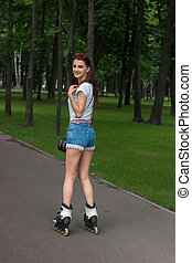 happy young girl rollerblading