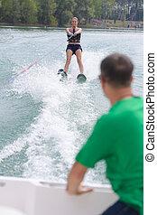 happy young girl water skiing