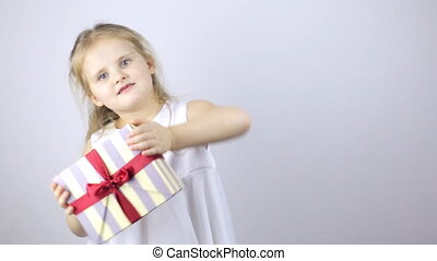 Happy young girl with a gift box