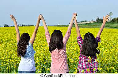 Happy young girls in field