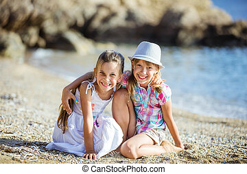 Happy young girls on the beach