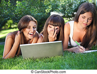 Happy young girls using a computer