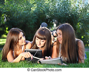 Happy young girls using a tablet computer