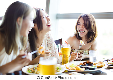 happy young group enjoying dinner party