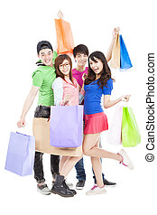 happy young group holding the shopping bags