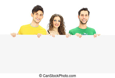Happy young group of people standing together and holding a blank sign for your text, isolated on white background