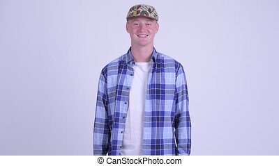 Happy young handsome hipster man smiling