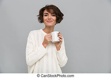 Happy young lady drinking tea. - Photo of happy young lady...