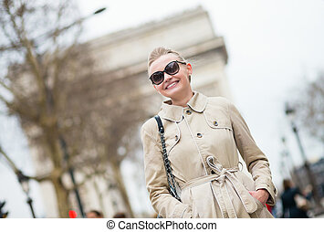 Happy young lady in Paris