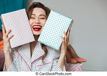 Happy young lady indoors with gift boxes. - Image of happy...