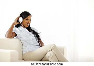 Happy young lady listening to music