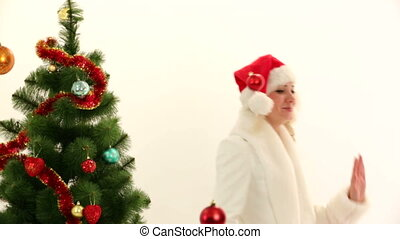 Happy Young Lady Playing With Decorations In Christmas Costume