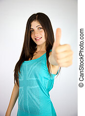 Happy young lady with freckles and long shiny hair thumb up