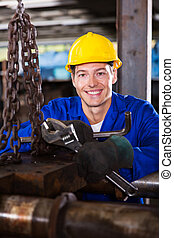 young male industrial mechanic
