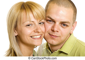 Happy young man and woman standing together