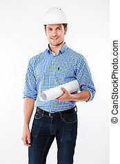 Happy young man building engineer in helmet holding blueprint