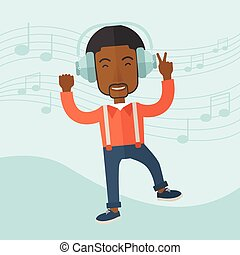 Happy young man dancing while listening to music.