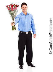 happy young man giving roses