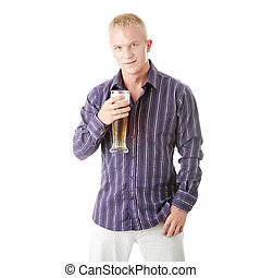 Happy young man holding a glass of beer