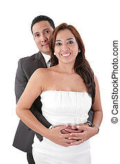 Happy young man hugging his girlfriend isolated on white background.  Focus in the woman.