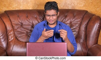 happy young man In a video conference discussing on smart phone