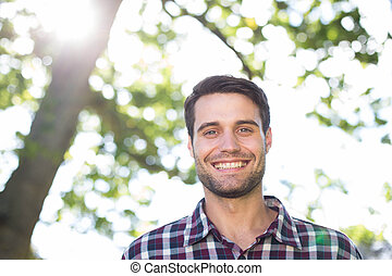 Happy young man in the park