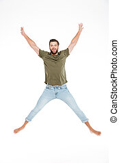 Happy young man jumping isolated over white background