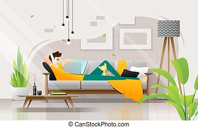 Happy young man lying on sofa with laptop in living room, relaxing weekend at home
