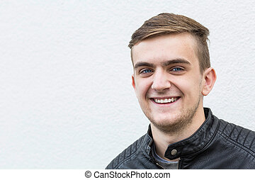 happy young man on white baclground