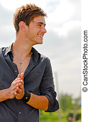 Happy young man smiling outdoors