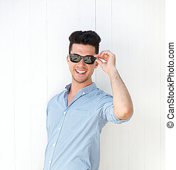 Happy young man smiling with sunglasses
