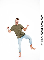 Happy young man standing isolated over white background