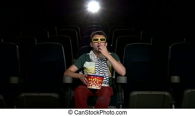 happy young man watching movie alone in empty theater, 3d...