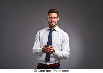 Happy young man with a smartphone