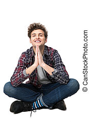 Happy young man with casual cloth sitting on the floor
