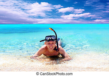 Happy young man with snorkling on a sea beach - Happy young...