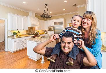 Young Mixed Race Family Having Fun in Custom Kitchen