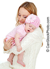 Happy young mother and sleeping baby on her shoulder