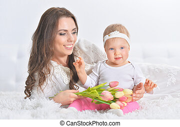Happy young mother with her little daughter