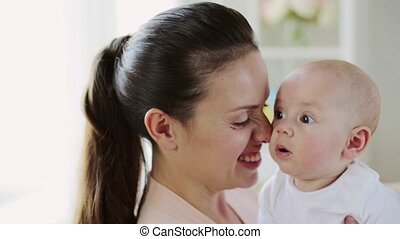happy young mother with little baby at home