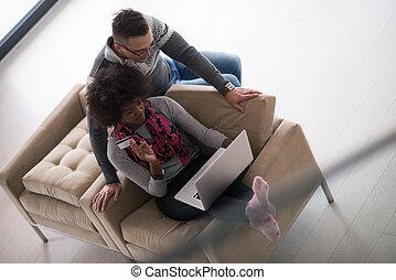 multiethnic couple shopping online