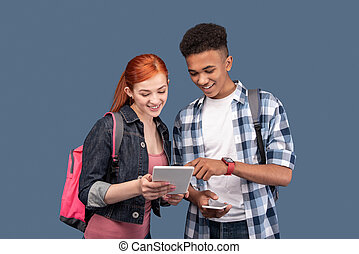 Happy young people using a tablet