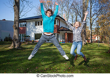 Happy young people with a new house