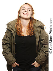 happy young redhead woman in parka on white background